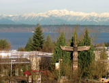 View from the Outreach Building of  the Totem outside Student Services/Admissions, Puget Sound and Olympic Mountains.