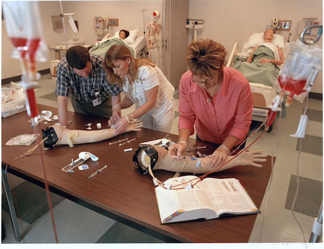 Maine College of Health Professions Photo - two students learning how to do IV's
