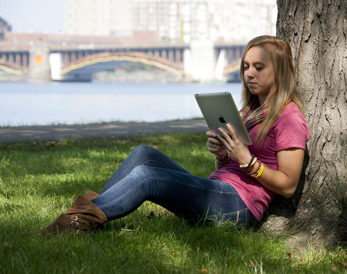 Fisher College Photo #1 - Fisher student studying in the Esplanade. The campus is steps away from The Charles River, Boston Common, and Public Garden.