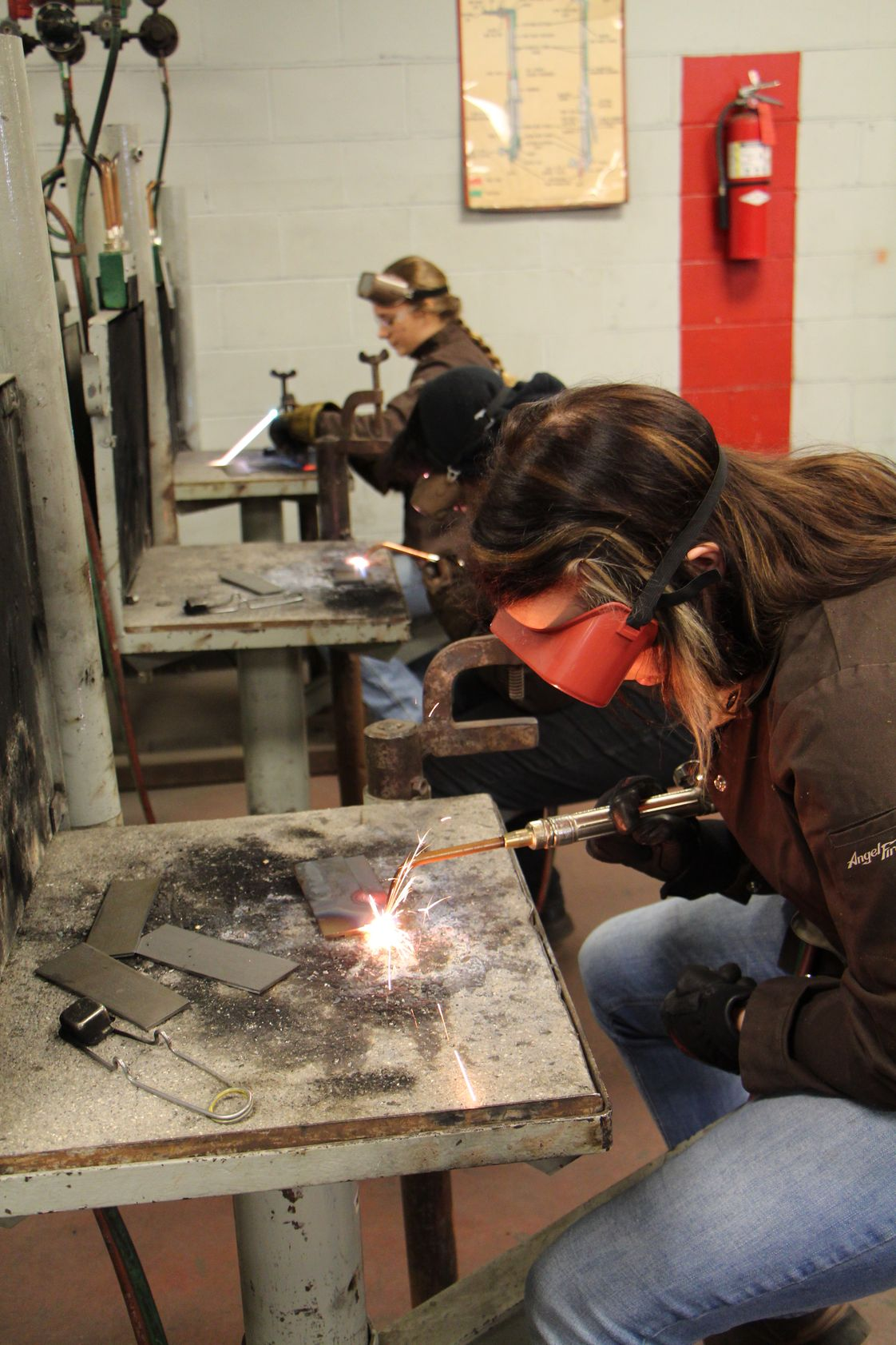 Dunwoody College of Technology Photo #1 - Welding students in a Dunwoody classroom/workshop