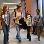 Whatcom Community College Photo #7 - Students walking down hall.